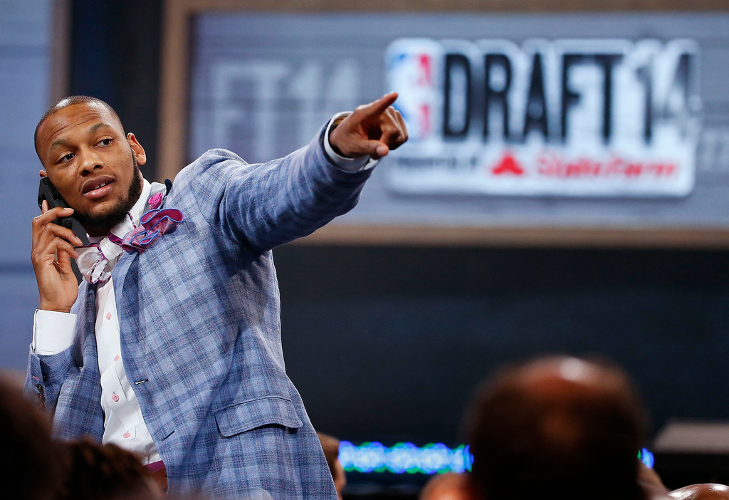 . NBA draft prospect Adreian Payne of Michigan State, points to fans before the start of  the 2014 NBA draft, Thursday, June 26, 2014, in New York. Payne was selected as the 15th overall pick by the Atlanta Hawks. (AP Photo/Jason DeCrow)