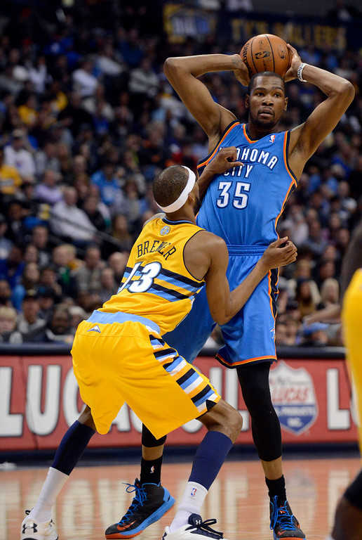 . DENVER, CO. - JANUARY 20: Denver Nuggets small forward Corey Brewer (13) closely guards Oklahoma City Thunder small forward Kevin Durant (35) as he looks to make a pass during the third quarter January 20,  2013 at Pepsi Center. The Denver Nuggets defeated the Oklahoma City Thunder 121-118.  (Photo By John Leyba / The Denver Post)