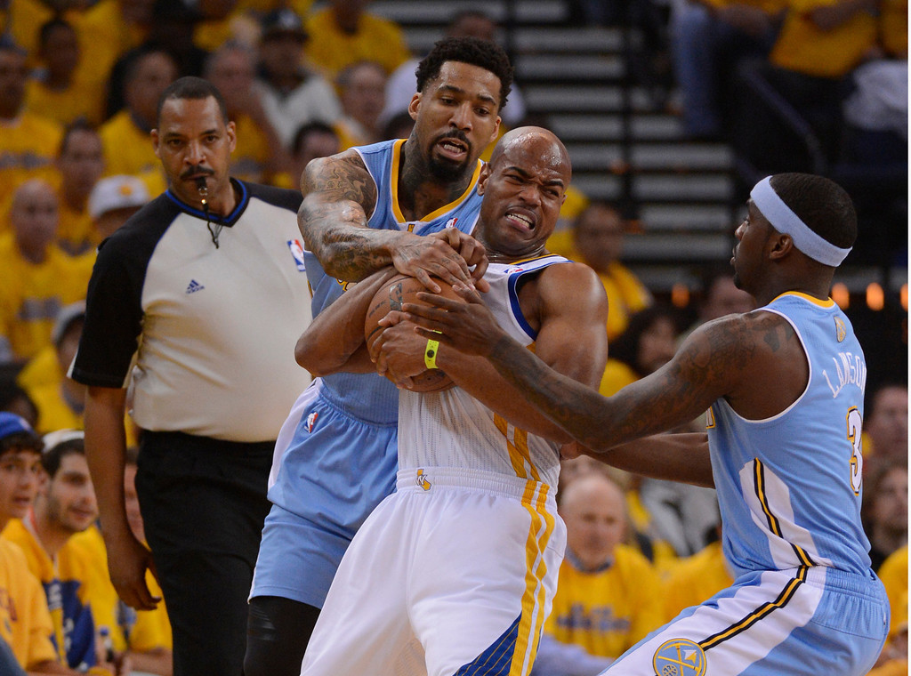 . OAKLAND, CA. - APRIL 26: Wilson Chandler (21) of the Denver Nuggets and Ty Lawson tie up Jarrett Jack (2) of the Golden State Warriors during the first quarter in game 3 of the first round of the NBA Playoffs April 26, 2013 at Oracle Arena.  (Photo By John Leyba/The Denver Post)