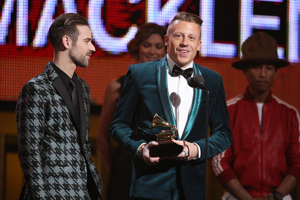 . Ryan Lewis, left, and Macklemore accept the award for best new artist at the 56th annual Grammy Awards at Staples Center on Sunday, Jan. 26, 2014, in Los Angeles. (Photo by Matt Sayles/Invision/AP)