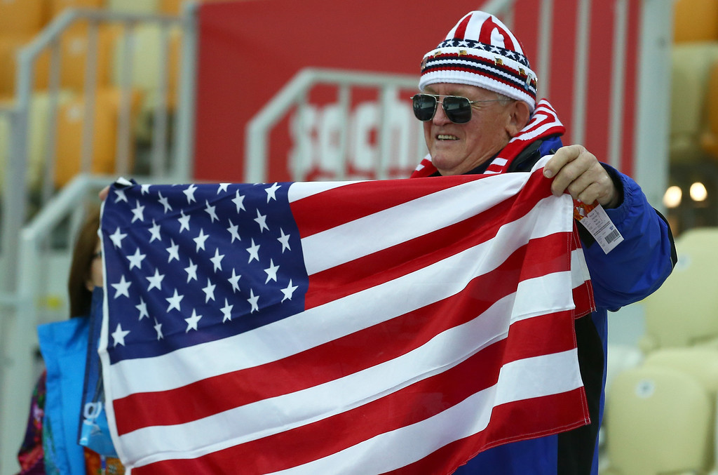 . A fan of the United States enjoys the atmosphere ahead of the Women\'s 3000m Speed Skating event during day 2 of the Sochi 2014 Winter Olympics at Adler Arena Skating Center on February 9, 2014 in Sochi, .  (Photo by Streeter Lecka/Getty Images)