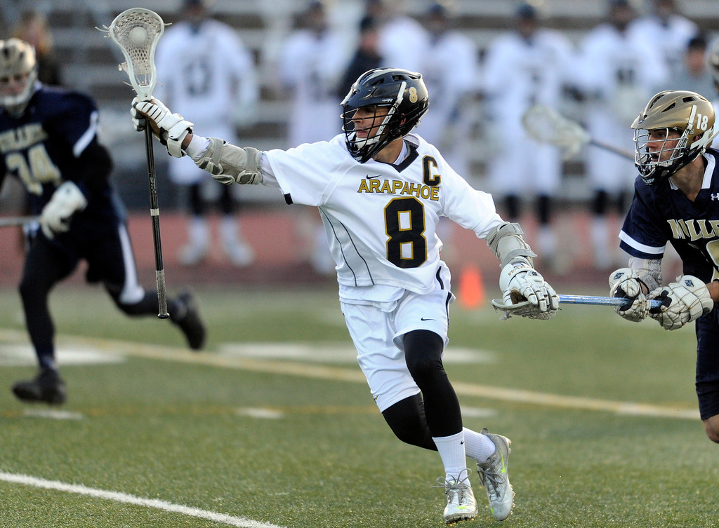 . LITTLETON, CO. - APRIL 10: Warriors senior middie Ben Eigner (8) collected the ball in the first half. The Mullen High School boy\'s lacrosse team defeated Arapahoe 8-7 Wednesday night, April 10, 2013. Photo By Karl Gehring/The Denver Post)