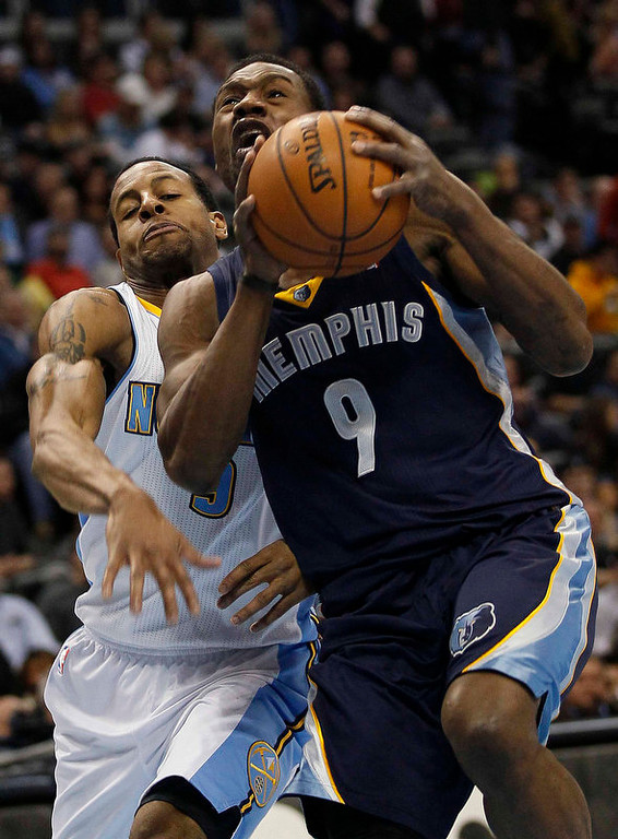 . Memphis Grizzlies forward Tony Allen (9) drives past Denver Nuggets center Andre Iguodala (back) in the third quarter of their NBA basketball game in Denver December 14, 2012.   REUTERS/Rick Wilking