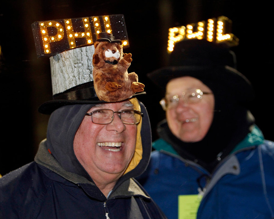 . Fred Ungar (L) of York, Pennsylvania and Barry Edwards of Lancaster, Pennsylvania joke around while waiting for the weather-prognosticating groundhog, Punxsutawney Phil, to make his annual prediction on Gobbler\'s Knob in Punxsutawney, Pennsylvania, on the 127th Groundhog Day February 2, 2013. REUTERS/Jason Cohn