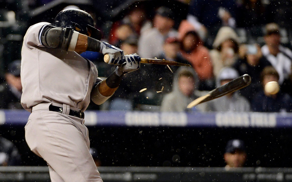 . DENVER, CO. - MAY 07: Robinson Cano (24) of the New York Yankees shatters his bat on a pitch from Jorge De La Rosa (29) of the Colorado Rockies during the fourth inning May 7, 2013 at Coors Field. (Photo By John Leyba/The Denver Post)