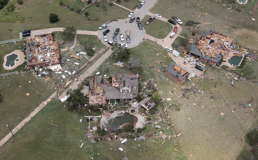. Heavily damaged homes Line a cul de sac in Granbury, Texas on Thursday May 16, 2013.   (AP Photo/The Fort Worth Star-Telegram, Ron T. Ennis)