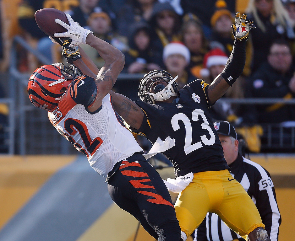 . Marvin Jones #82 of the Cincinnati Bengals tries to make a second quarter catch but its broken up by Keenan Lewis #23 of the Pittsburgh Steelers at Heinz Field on December 23, 2012 in Pittsburgh, Pennsylvania. (Photo by Gregory Shamus/Getty Images)