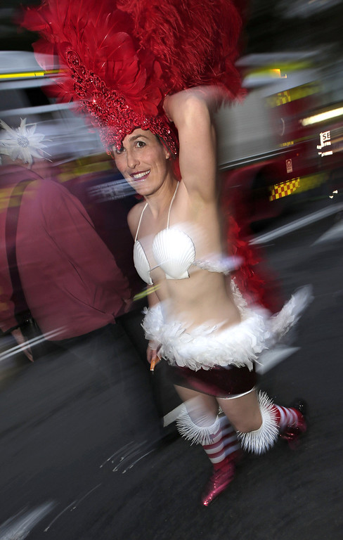 . A parade participant celebrates Mardi Gras in Sydney, Australia, Saturday, March 2, 2013. 10,000 are marching along side 115 floats in the annual parade that celebrates lesbian and gay pride. (AP Photo/Rick Rycroft)