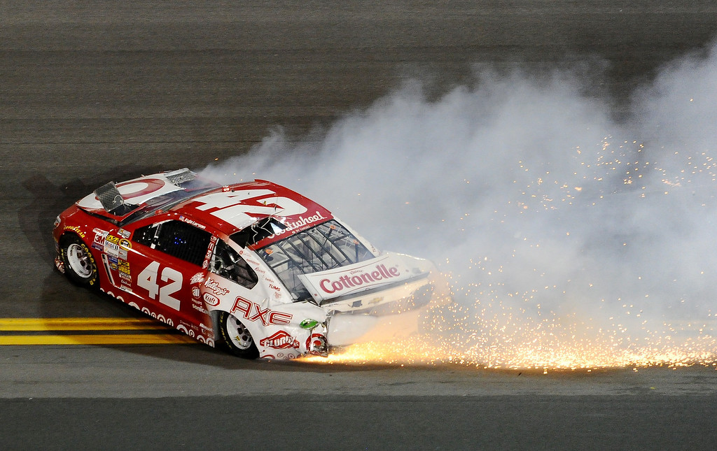 . Kyle Larson, driver of the #42 Target Chevrolet, is involved in an incident during the NASCAR Sprint Cup Series Daytona 500 at Daytona International Speedway on February 23, 2014 in Daytona Beach, Florida.  (Photo by Robert Laberge/Getty Images)