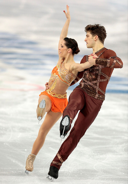 Description of . Nicole Della Monica and Matteo Guarise of Italy compete in the pairs short program figure skating competition at the Iceberg Skating Palace during the 2014 Winter Olympics, Tuesday, Feb. 11, 2014, in Sochi, Russia. (AP Photo/Ivan Sekretarev)