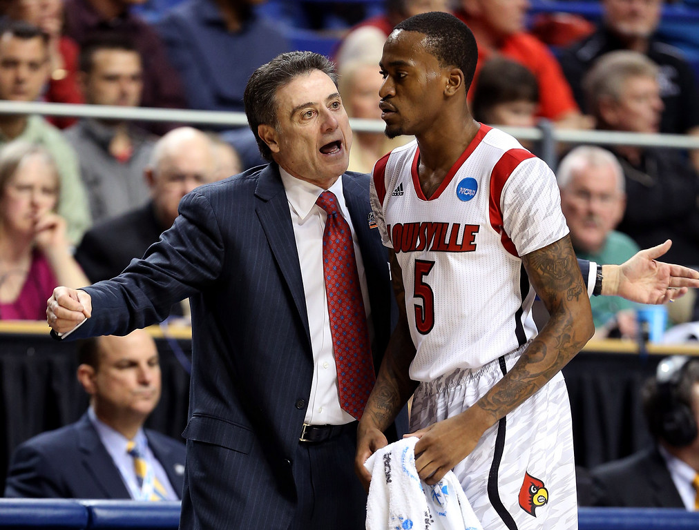 . LEXINGTON, KY - MARCH 23: Head coach Rick Pitino of the Louisville Cardinals talks to Kevin Ware #5 in the first half against the Colorado State Rams during the third round of the 2013 NCAA Men\'s Basketball Tournament at Rupp Arena on March 23, 2013 in Lexington, Kentucky.  (Photo by Andy Lyons/Getty Images)