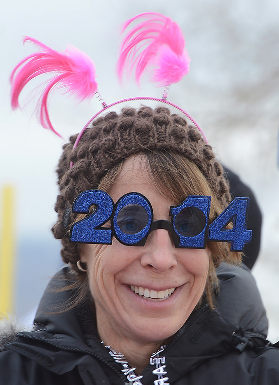 . Christine Jones is dressed for the occasion on Wednesday. The 31st annual Boulder Polar Plunge, at the Boulder Reservoir on New Year�s Day, to help the Boulder County AIDS Project and connectBCAP.  Cliff Grassmick/Daily Camera