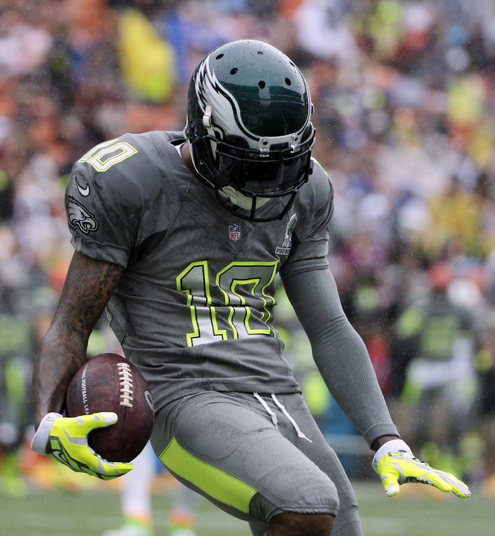 . Philadelphia Eagles DeSean Jackson (10) of Team Sanders celebrates after making a catch for a touchdown in the first half during the Pro Bowl, Sunday, Jan. 26, 2014, at Aloha Stadium in Honolulu. (AP Photo/Eugene Tanner)