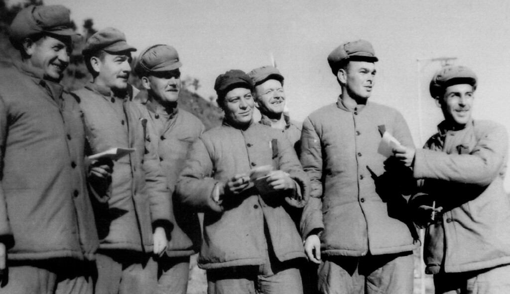 . William Funchess, second from right, is photorgraphed while he was a prisoner of war in North Korea. Funchess said the photo was taken by Frank Noel, a captured war correspondent, who was forced by the Chinese to take propaganda photos to show that prisoners were not being mistreated.  (Courtesy of William Funchess/Wichita Eagle/MCT)