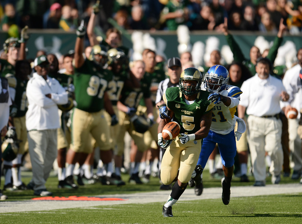 . FORT COLLINS, CO - OCTOBER 12 : Kapri Bibbs of Colorado State (5) passes Bene Benwikere of San Jose State (21) towards a 1st down in the 2nd quarter of the game at Hughes Stadium. Fort Collins. Colorado. October 12, 2013. San Jose won 34-27. (Photo by Hyoung Chang/The Denver Post)