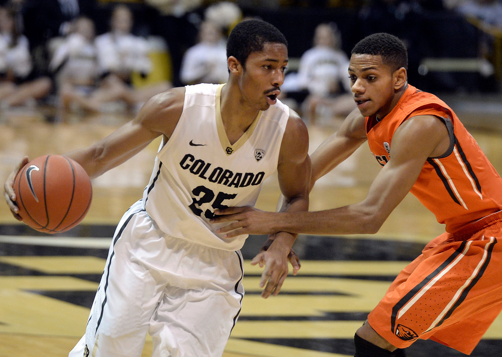 . Colorado\'s Spencer Dinwiddie dribbles past Hallice Cooke during an NCAA game against Oregon State on Thursday, Jan. 2, at the Coors Event Center in Boulder. Jeremy Papasso/ Camera