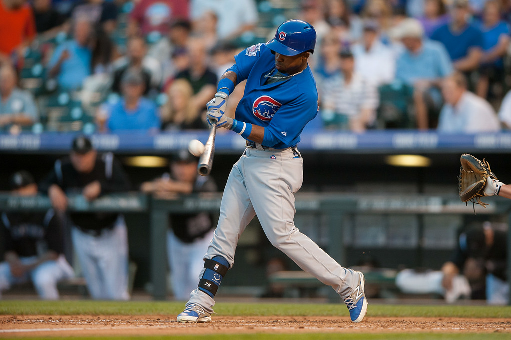 . DENVER, CO - AUGUST 06:  Arismendy Alcantara #7 of the Chicago Cubs hits a 2-run home run off of Jordan Lyles #24 of the Colorado Rockies (not pictured) in the fourth inning of a game at Coors Field on August 6, 2014 in Denver, Colorado.  (Photo by Dustin Bradford/Getty Images)