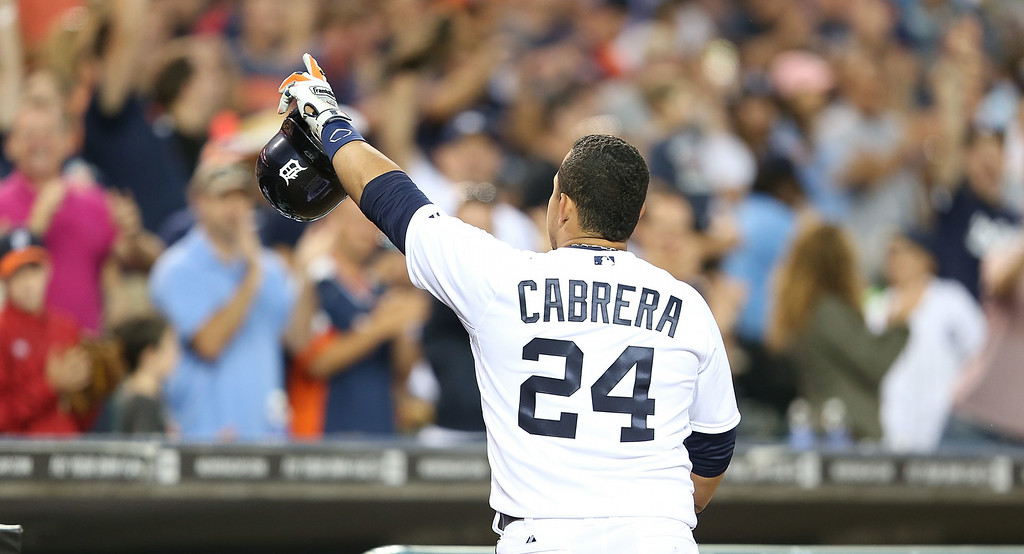 . DETROIT, MI - AUGUST 02: Miguel Cabrera #24 of the Detroit Tigers celebrates after hitting a solo home run to center field during the third inning of the game against the Colorado Rockies at Comerica Park on August 2, 2014 in Detroit, Michigan.  (Photo by Leon Halip/Getty Images)