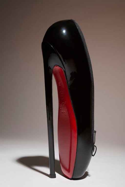 ". Christian Louboutin\'s ""Fetish Ballerine\"" pump. The shoe is on display at the \""Shoe Obsession\"" exhibit at The Museum at the Fashion Institute of Technology Museum in New York. The exhibition, showing off 153 specimens, runs through April 13. (AP Photo/Fashion Institute of Technology)"