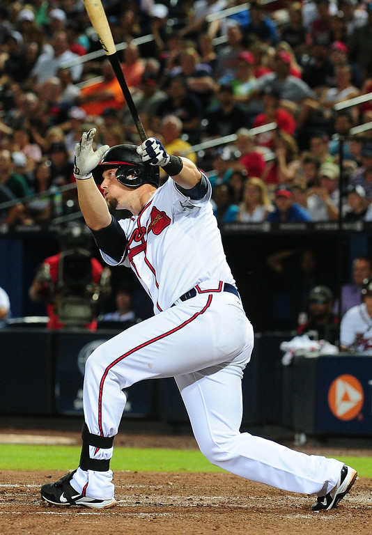 . Chris Johnson #23 of the Atlanta Braves hits a run scoring single in the 7th inning against the Colorado Rockies at Turner Field on August 1, 2013 in Atlanta, Georgia. (Photo by Scott Cunningham/Getty Images)