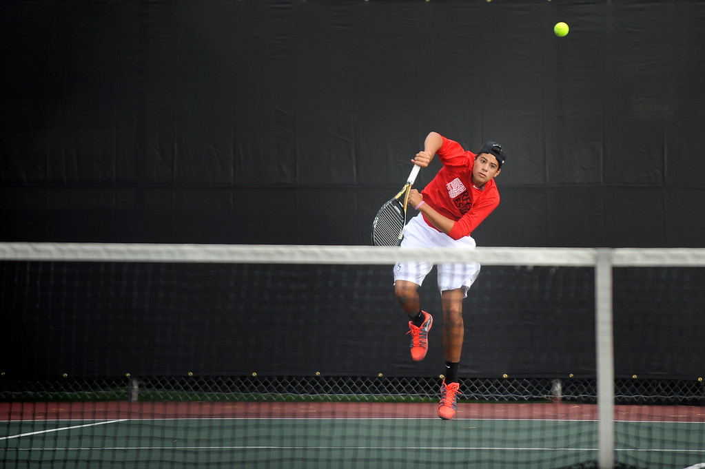 . DENVER, CO. - OCT 12:   Luca Abbott, of Regis Jesuit, hits the ball during his doubles match against Fossil Ridge on the final day of the 5A Boys\' Tennis Championships at Gates Tennis Center on Oct. 12, 2013.  (Photo By Erin Hull/The Denver Post)