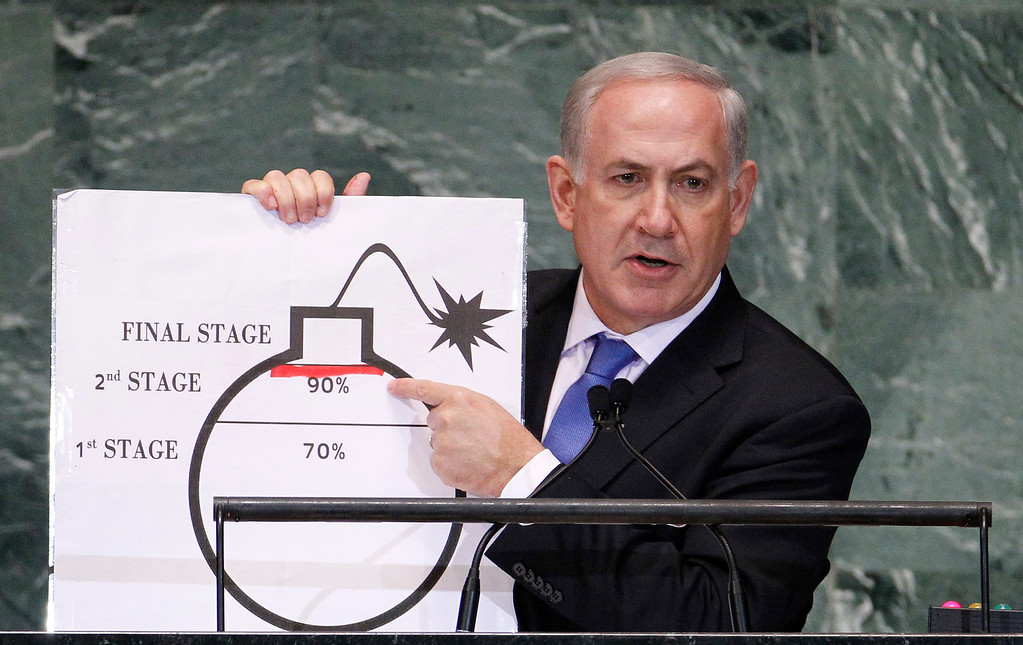 . Israel\'s Prime Minister Benjamin Netanyahu points to a red line he has drawn on the graphic of a bomb as he addresses the 67th United Nations General Assembly at the U.N. Headquarters in New York, September 27, 2012. REUTERS/Lucas Jackson