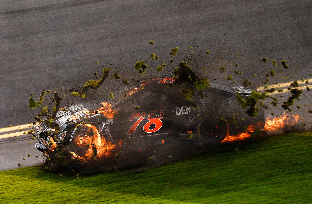 . Martin Truex Jr., driver of the #78 Furniture Row Chevrolet, is involved in an incident during the NASCAR Sprint Cup Series Budweiser Duel 2 at Daytona International Speedway on February 20, 2014 in Daytona Beach, Florida.  (Photo by Jared C. Tilton/Getty Images)