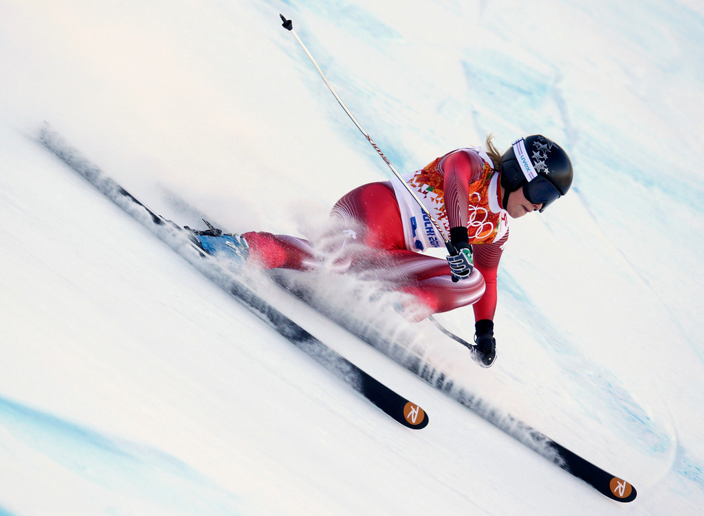 . Switzerland\'s Lara Gut makes a turn in the women\'s downhill at the Sochi 2014 Winter Olympics, Wednesday, Feb. 12, 2014, in Krasnaya Polyana, Russia. (AP Photo/Charles Krupa)