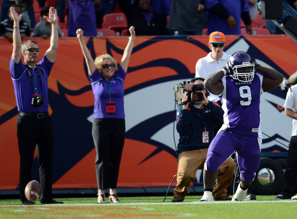 . Denver South RB Trevonte Tasco celebrate the touchdown against Monarch defense during 4A State Championship game at Sports Authority Field at Mile High on Saturday, Dec. 1, 2012. Monarch won 17-14. Hyoung Chang, The Denver Post