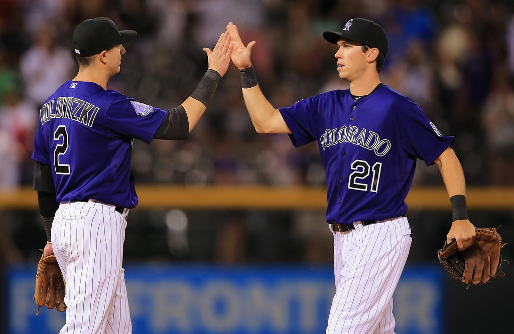 . Troy Tulowitzki #2 of the Colorado Rockies and Tyler Colvin #21 of the Colorado Rockies celebrate their 8-3 victory over the Washington Nationals at Coors Field on June 11, 2013 in Denver, Colorado.  (Photo by Doug Pensinger/Getty Images)