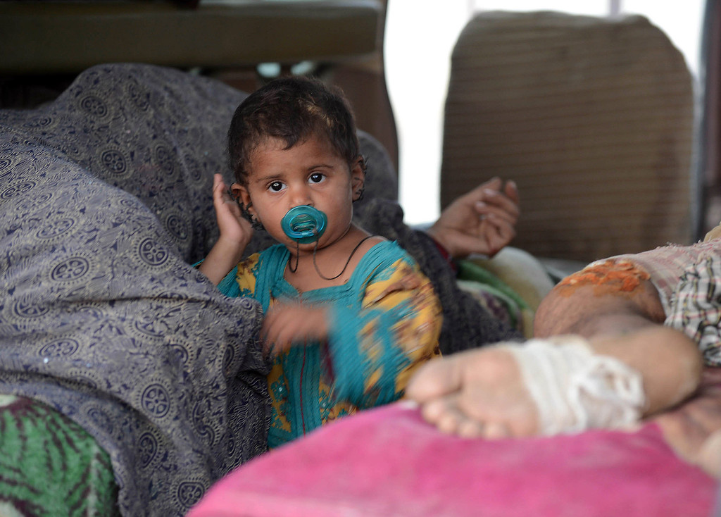 . A baby girl stands next to her mother injured in an earth quake in an ambulance before shifting to a Karachi hospital in the devastated district of Awaran on September 28, 2013. A powerful 6.8-magnitude earthquake hit southwest Pakistan, killing at least 22 people in a region already devastated by a tremor which left more than 300 people dead this week, local officials said. BANARAS KHAN/AFP/Getty Images