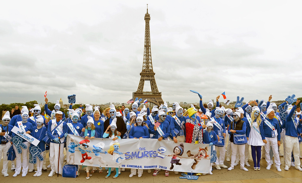 . (From 7th L)Veronique Culliford, the daughter of late cartoonist Peyo, the creator of The Smurfs, and producer Jordan Kerner, and Smurf Ambassadors pose for a group photo on the Trocadero plaza as part of Global Smurfs Day celebrations on June 22, 2013 in Paris, France. The Eiffel tower is seen behind.  (Photo by Pascal Le Segretain/Getty Images for Sony Pictures Entertainment)