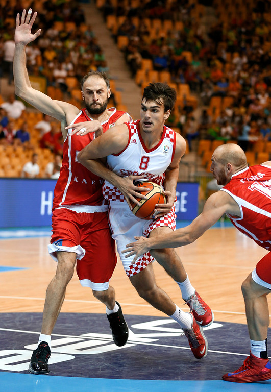 . Dario Saric The 6-foot-10 Croatian reportedly agreed to a three-year deal to stay with the Turkish team Anadolu Efes, but his size and versatility may be too valuable for the Nuggets to pass up at No. 11. And his deal to play overseas may actually work out in the Nuggets� favor down the road. Croatia\'s Dario Saric, center, drives a ball past Georgia\'s Besik Lezhava, right, and Georgia\'s Viktor Sanikidze, left, during their EuroBasket European Basketball Championship Group C match in Celje, Slovenia, Thursday, Sept. 5, 2013. (AP Photo/Petr David Josek)
