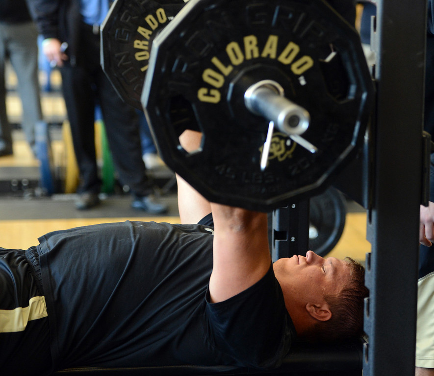 . Will Pericak knocks out his bench presses on Wednesday. Scouts from around the NFL  tested and watched University of Colorado football players during CU pro timing day on Wednesday. (Cliff Grassmick/Boulder Daily Camera)