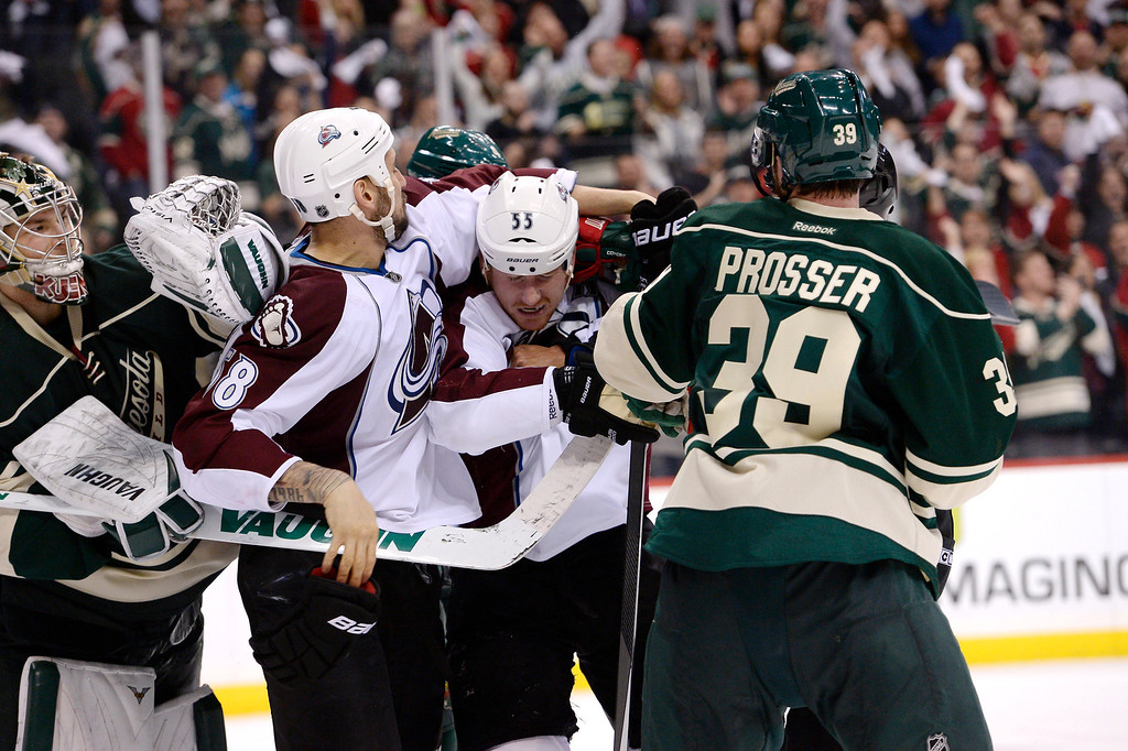 . Colorado Avalanche left wing Cody McLeod (55) and Colorado Avalanche left wing Patrick Bordeleau (58) mix it up with Minnesota Wild defenseman Nate Prosser (39) at the end of the game April 28, 2014 in Game 6 of the Stanley Cup Playoffs at Xcel Energy Center. Minnesota Wild defeated the Colorado Avalanche 5-2 to force a game 7 in Denver.  (Photo by John Leyba/The Denver Post)