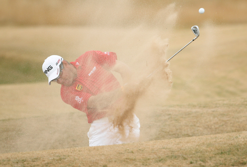 . Lee Westwood of England plays out of a bunker on the 9th hole during the final round of the British Open Golf Championship at Muirfield, Scotland, Sunday July 21, 2013. (AP Photo/Peter Morrison)