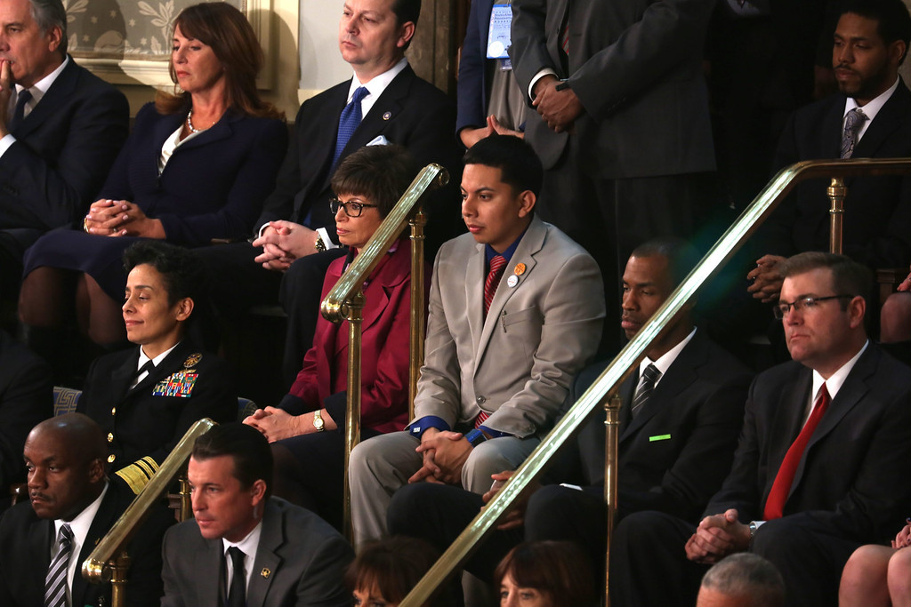 . Mi Familia Vota\'s Cristian Avila (C) sits with Senior Advisor to the President of the United States Valerie Jarrett (CL) as US President Barack Obama delivers his State of the Union address before a joint session of Congress on the floor of the US House of Representatives in the US Capitol in Washington, DC, USA, 28 January 2014.  EPA/JIM LO SCALZO