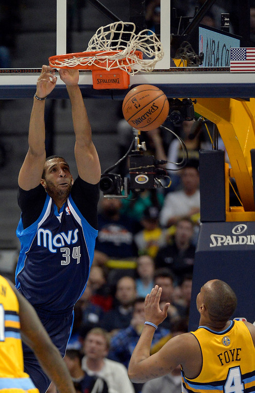 . Dallas Mavericks power forward Brandan Wright (34) gets a dunk during the first quarter as Denver Nuggets shooting guard Randy Foye (4) looks on March 5, 2014 at Pepsi Center. (Photo by John Leyba/The Denver Post)