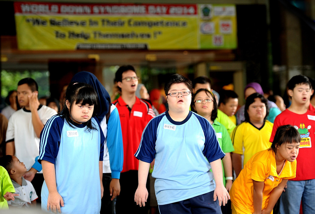 . Indonesian children with Down syndrome dance together as they celebrate World Down Syndrome Day on March 21, 2014 in Surabaya, Indonesia. 21 March 2014 marks the 9th anniversary of World Down Syndrome Day and focuses on supporting all people with Down syndrome on their right to access healthcare without discrimination and with proper assessment of the specific health needs of the individual.  (Photo by Robertus Pudyanto/Getty Images)