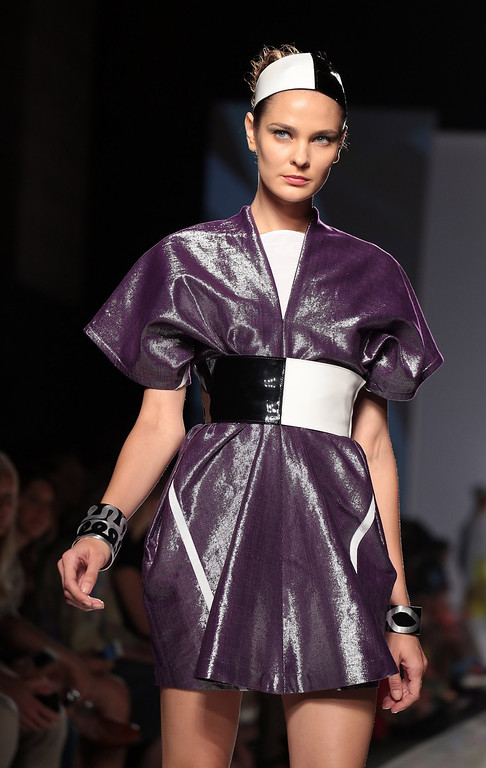 . A model displays a creation by Sabine Portenier and Evelyne Roth during It\'s Ethical Fashion \'Bring Africa to Rome\' catwalk collection S/S 2014 fashion show as part of AltaRoma AltaModa Fashion Week at Santo Spirito In Sassia on July 7, 2013 in Rome, Italy.  (Photo by Elisabetta Villa/Getty Images)