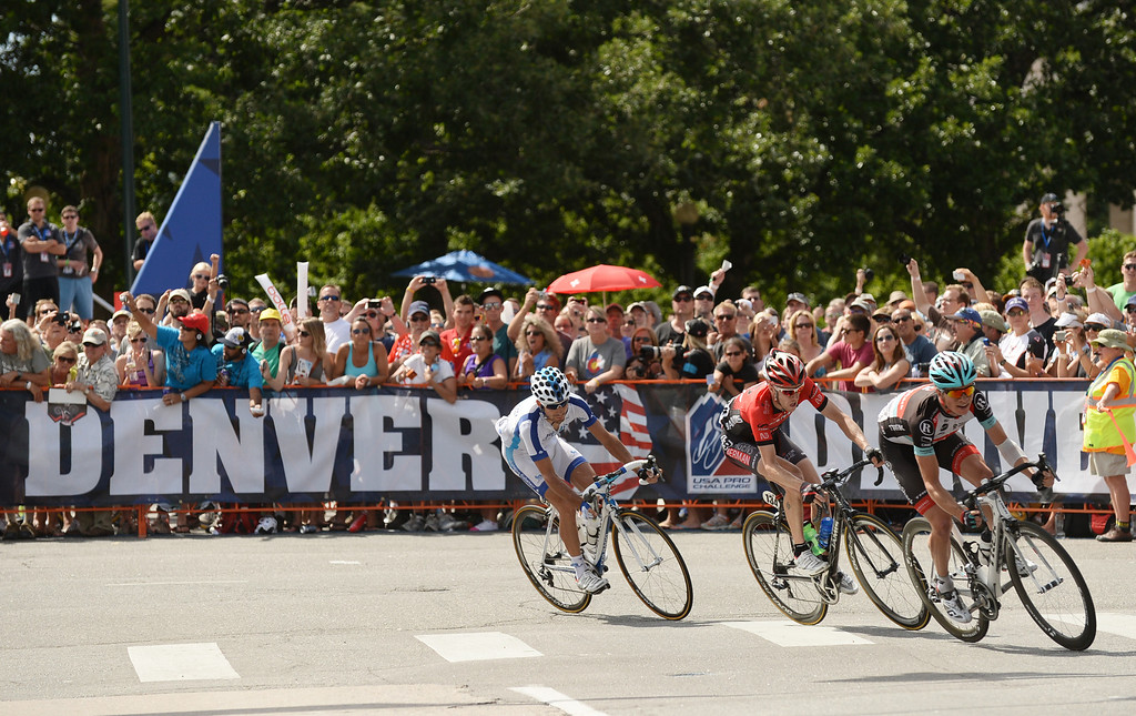 . Cyclists ride in downtown Denver during the 75-mile 7th stage of the 2013 USA Pro Challenge race in Denver, Colorado on August 25, 2013. (Photo by Hyoung Chang/The Denver Post)