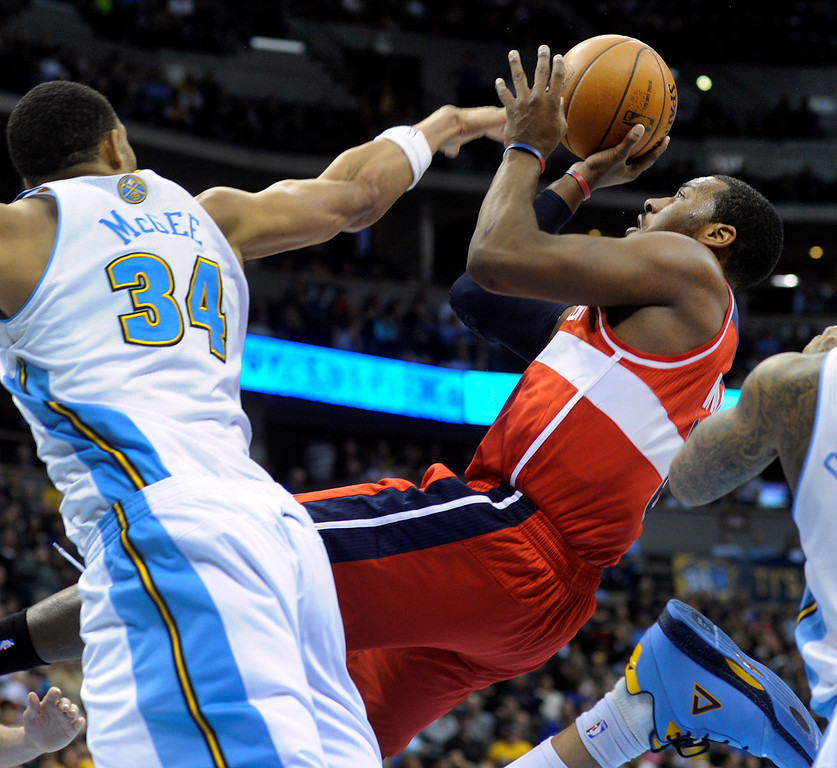 . DENVER, CO - JANUARY 18: Denver center JaVale McGee tried to block a shot by Washington guard John Wall in the second half. The Washington Wizards defeated the Denver Nuggets 112-108 at the Pepsi Center Friday night, January 18, 2013. Karl Gehring/The Denver Post