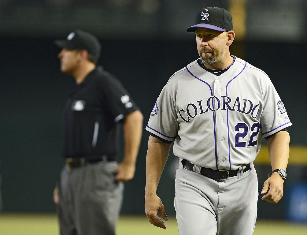 . Manager Walt Weiss #22 of the Colorado Rockies walks back to the dugout after discussing a call with the first base umpire against the Arizona Diamondbacks in the first inning at Chase Field on September 15, 2013 in Phoenix, Arizona.  (Photo by Jennifer Stewart/Getty Images)