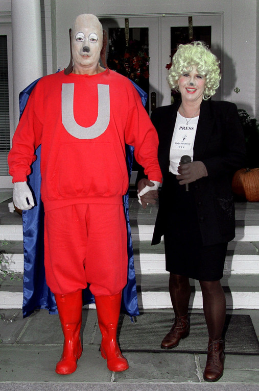 """. Vice President Al Gore, left, and his wife Tipper Gore pose in their Halloween costumes at the vice president\'s residence at the Naval Observatory in Washington Sunday, Oct. 31, 1999.  The vice president is attired as the cartoon character \""""Underdog\"""" and his wife as \""""Polly Purebred\"""".    (AP Photo/Ron Thomas)"""