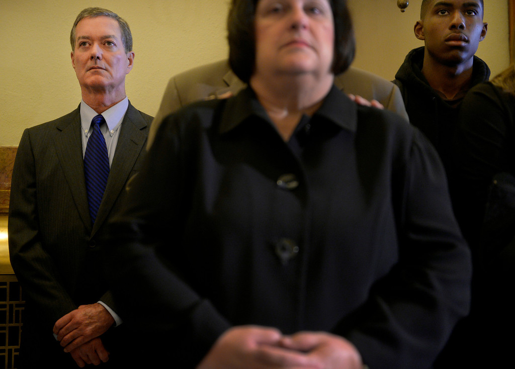 . Former Governor Bill Owens bows his head during a service for former Lt. Gov. Joe Rogers, at the state Capitol in Denver, CO October 15, 2013. (Photo By Craig F. Walker / The Denver Post)