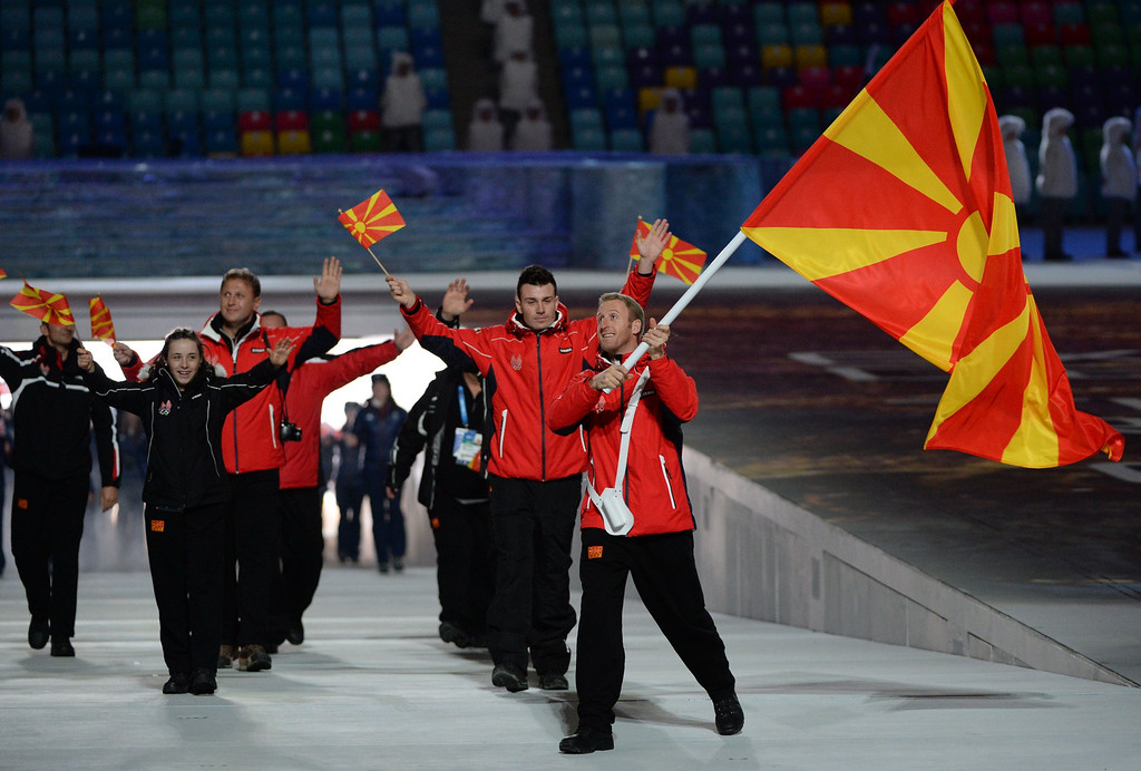 . Macedonia\'s flag bearer, cross-country skier Darko Damjanovski leads his national delegation during the Opening Ceremony of the Sochi Winter Olympics at the Fisht Olympic Stadium on February 7, 2014 in Sochi. AFP PHOTO / ANDREJ ISAKOVIC/AFP/Getty Images