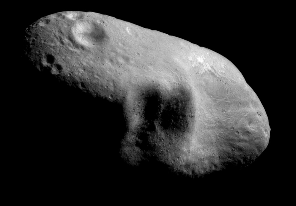 . This March 3, 2000 image provided by NASA shows the near-Earth asteroid Eros from the NEAR spacecraft at a distance of 127 miles (204 kilometers).  A group of high-tech tycoons wants to mine nearby asteroids, hoping to turn science fiction into real profits. The mega-million dollar plan is to use commercially built robotic ships to squeeze rocket fuel and valuable minerals like platinum and gold out of the lifeless rocks that routinely whiz by Earth. One of the company founders predicts they could have their version of a space-based gas station up and running by 2020.  (AP Photo/NASA)