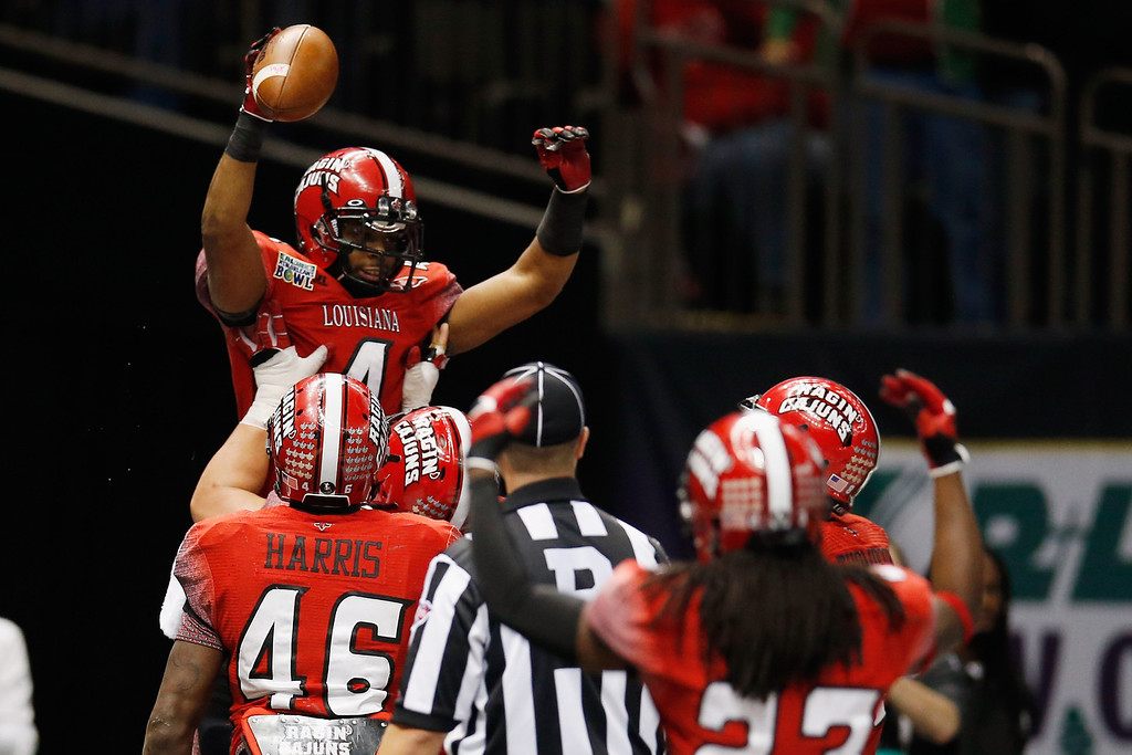 . Javone Lawson #4 of the Louisiana-Lafayette Ragin Cajuns celebrates after scoring a touchdown against the East Carolina Pirates during the R+L Carriers New Orleans Bow at the Mercedes-Benz Superdome on December 22, 2012 in New Orleans, Louisiana.  (Photo by Chris Graythen/Getty Images)