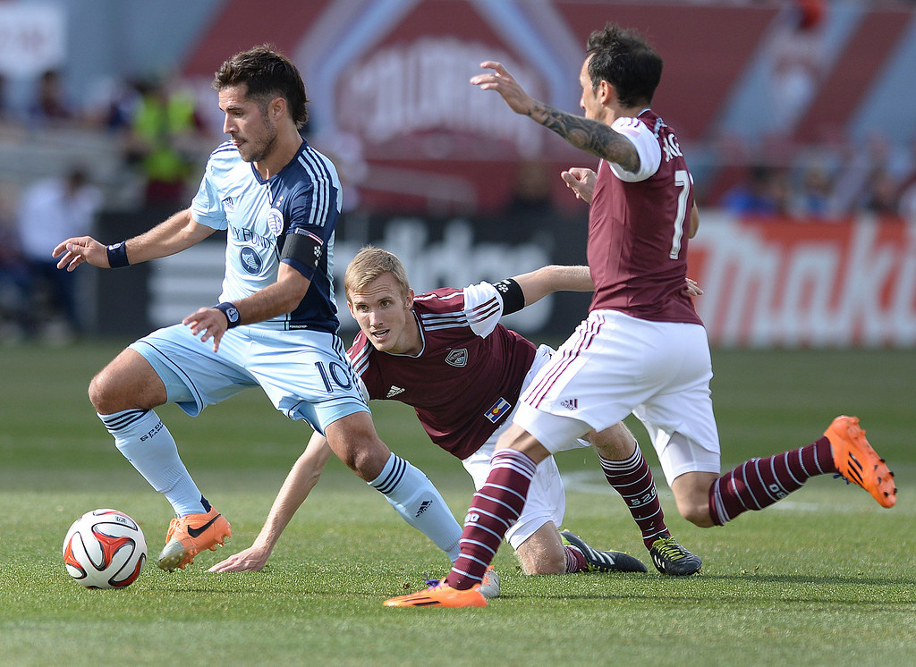 . Kansas City midfielder Benny Feilhaber (10) worked through traffic in the first half. The Colorado Rapids hosted Sporting Kansas City Saturday evening, March 29, 2014 at Dick\'s Sporting Goods Stadium in Commerce City.  (Photo by Karl Gehring/The Denver Post)