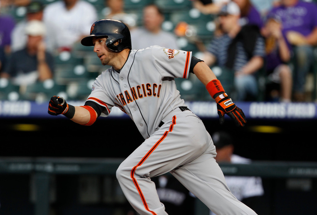. San Francisco Giants\' Marco Scutaro breaks from the batter\'s box after singling against the Colorado Rockies in the first inning of a baseball game in Denver, Saturday, May 18, 2013. (AP Photo/David Zalubowski)